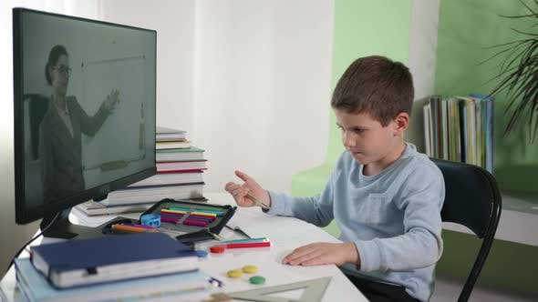 Thumbnail for Distance Education, Male Child Learns Lessons Online with Female Teacher Using Modern Technologies