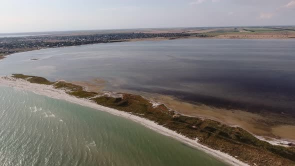 Thumbnail for Aerial Shot of a Curvy Sand Spit at the Black Sea Shelf on a Sunny Day in Summer