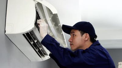 technician service removing air filter of the air conditioner for cleaning