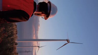 Vertical Video engineer near the with turbines