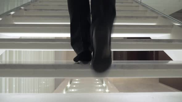 Thumbnail for Woman Walking Up White Stairway in the Hotel