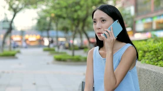 Thumbnail for Woman using cellphone for audio message