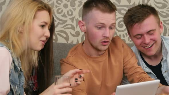 Thumbnail for Four Hipsters Communicate Via Video Conference Using Tablet