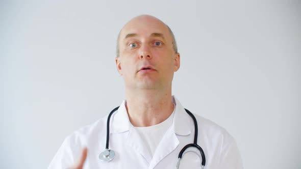 Thumbnail for Professional Male Doctor Explaining Diagnosis and Calming Patient
