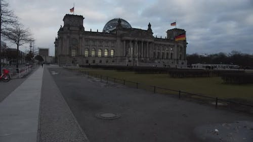 SLOW MOTION: Bundestag, Reichstag Roof From Distamce in Berlin, Germany on Cloudy Day