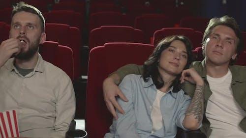 Spectators Watching Interesting Movie in Cinema