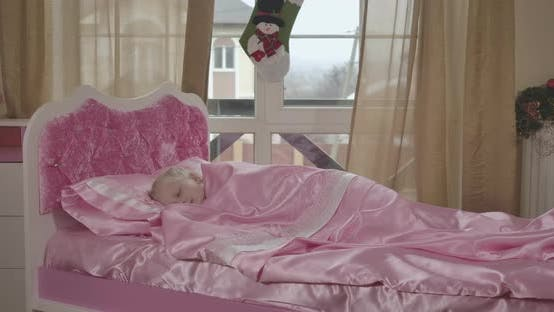 Thumbnail for Portrait of Cute Caucasian Girl Sleeping in Pink Bed. Calm Child Resting in the Morning in Her Room