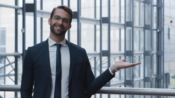 Thumbnail for Handsome Businessman Gesturing To Camera