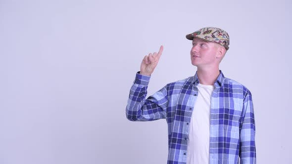 Thumbnail for Happy Young Handsome Hipster Man Thinking and Pointing Up