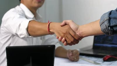 Architect Shaking Hands With Client