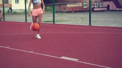 The Woman Plays Basketball