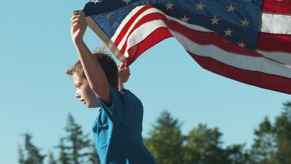 Thumbnail for Boy running with American flag, shot on Phantom Flex 4K