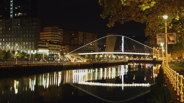 Night View at Arch Footbridge Across Nervion River in Bilbao, Spain, Timelapse