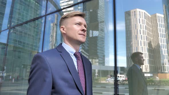 Thumbnail for Walking Businessman in Suit