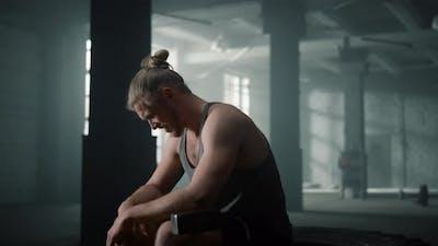 Sportsman Sitting on Crossfit Tire