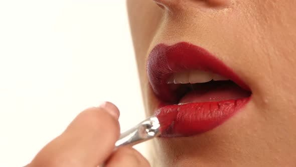 Thumbnail for Woman's Lips with Bright Fashion Red Glossy Makeup. Close Up
