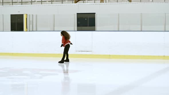 Cover Image for Little Athlete Skating on Indoor Ice Rink