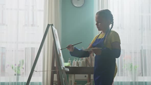 Small Girl Is Inspired to Paint