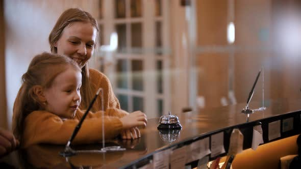 Thumbnail for A Family Checking in the Luxury Hotel - a Little Girl Climbs on Reception Stand