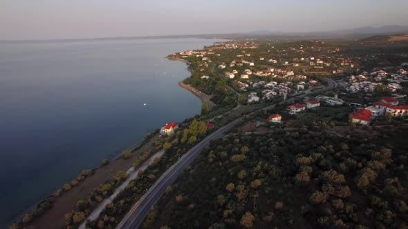 Thumbnail for Flying Over Trikorfo Beach Coastline with Cottages and Green Uplands, Greece