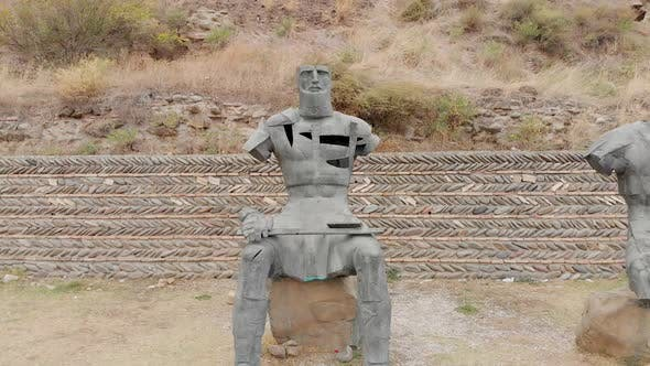 Zoom In Close Up View To Sitting Gori Soldier Statue