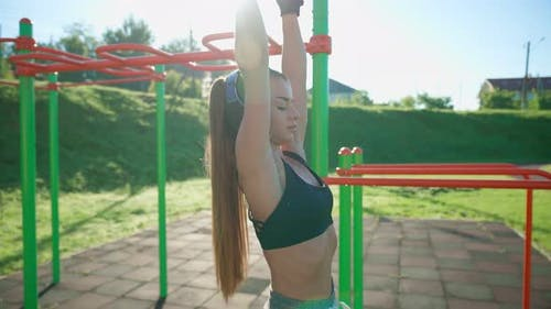 Woman Training Abdominal Muscles Hanging Off