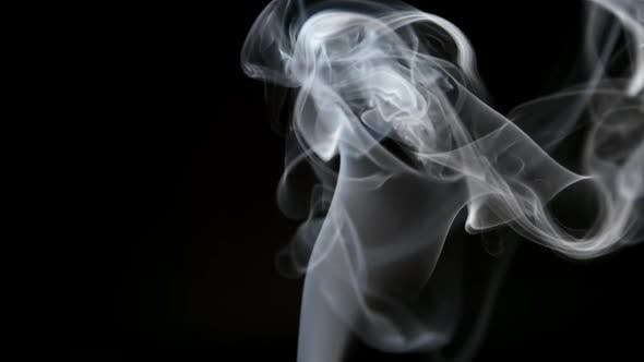 Thumbnail for Elegant Smoke Lifts Up On A Dark Background