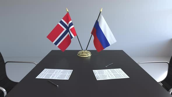 Thumbnail for Flags of Norway and Russia and Papers on the Table