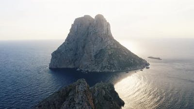 Famous Cliff and Ocean in Ibiza with Sunlight in Background