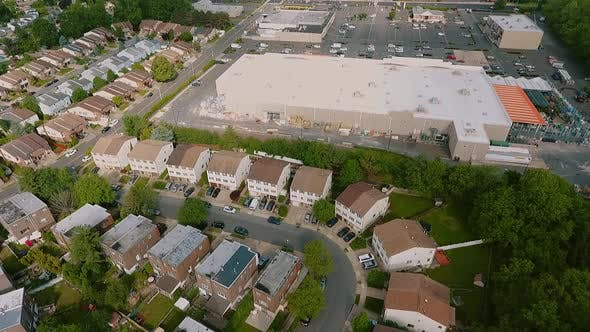 Thumbnail for Aerial View Establishing Shot of American Neighborhood,, Suburb and Logistics Center with Warehouse