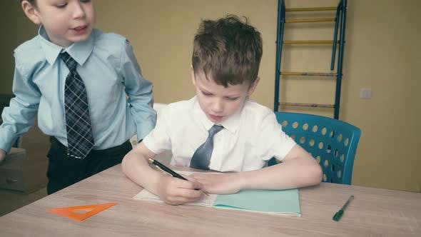Thumbnail for Tracking: Pupils Do Homework, Write Numbers in Notebooks, Help Each Other