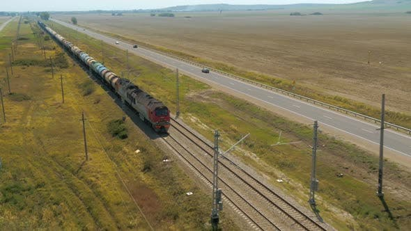 Thumbnail for A Freight Train Is Riding By Rail