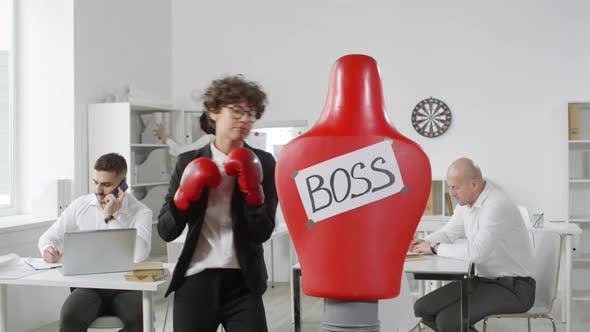 Thumbnail for Curly Office Worker Punching Boxing Dummy