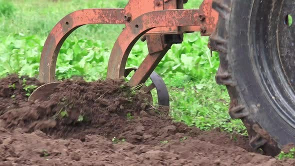 Old Soviet Tractor And Plowing 4