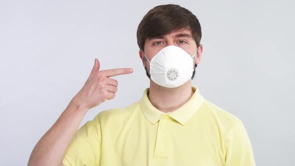 Thumbnail for Man Wears Respiratory Mask for Protection From Virus and Pointing on It with Fingers