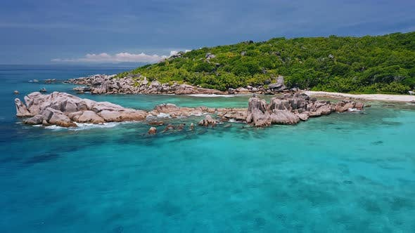 Cover Image for Aerial View of Unique Coastline with Surreal Nature Granite Boulders on Remote Paradise Like Beach