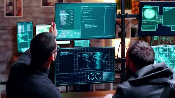 Two Male Hacker Making Their Attack Plan