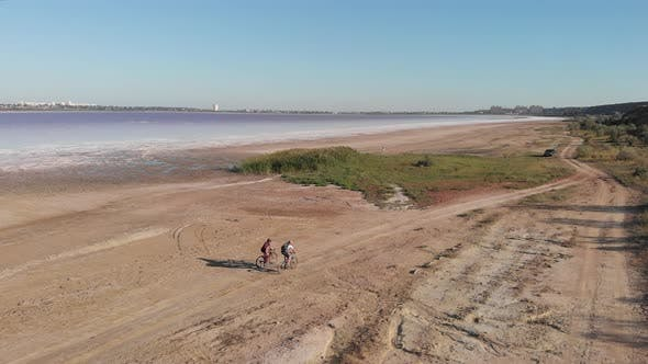 Thumbnail for Travellers ride bikes around Kuyalnik estuary, aerial drone view