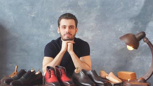 Man Has Prepared Footwears for Sale, Business, Trade Concepts, Guy Selling Trendy Footwear