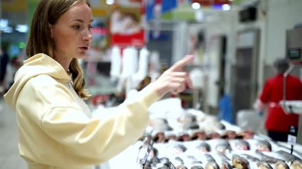 Thumbnail for Beautiful Woman Buying Fish in a Fish Shop