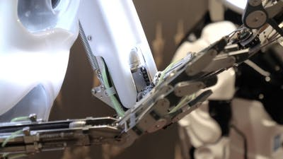 Futuristic robotic cyborg arms in action.