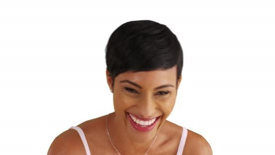 Thumbnail for Lovely black female laughing at camera joyfully in studio with copyspace