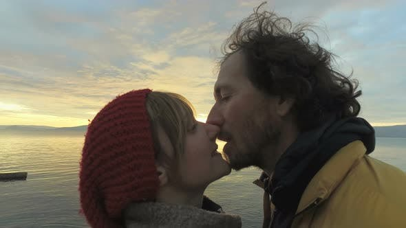 Thumbnail for Couple kissing at sunset on at seaside