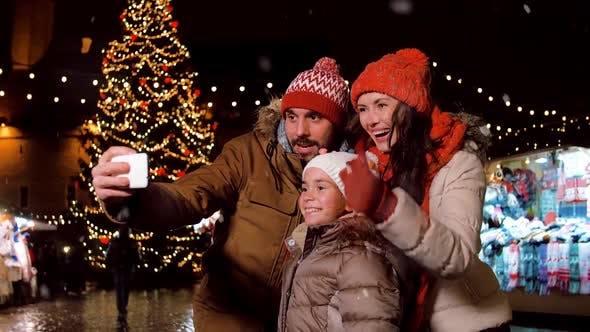 Thumbnail for Happy Family Taking Selfie at Christmas Market