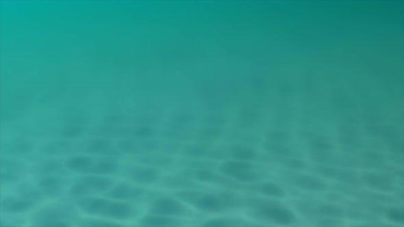 Thumbnail for Sunbeams pierce an aqua blue sea, illuminating a sandy seabed.