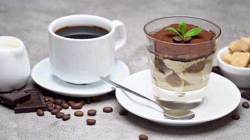 Classic Tiramisu Dessert in a Glass, Coffee, Chocolate, Cream and Sugar on Concrete Background
