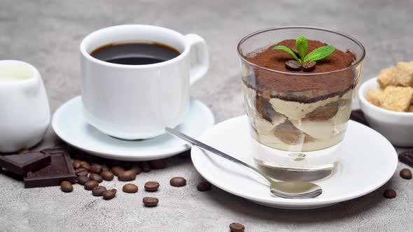 Classic Tiramisu Dessert in a Glass, Coffee, Chocolate, Cream and Sugar on Concrete Background
