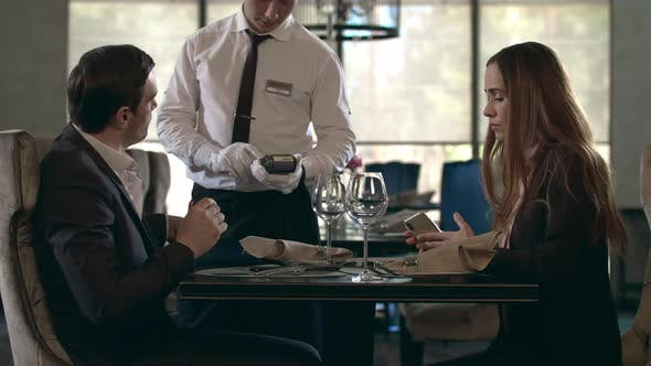 Thumbnail for Business Man Paying Restaurant Bill By Credit Card. Businessman Paying for Bill