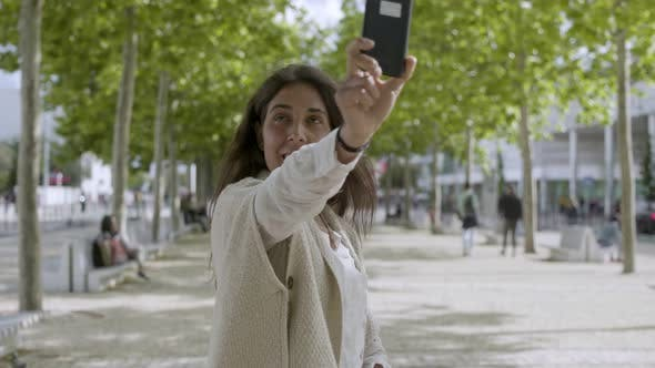 Thumbnail for Cheerful Middle Aged Woman Recording Video with Smartphone