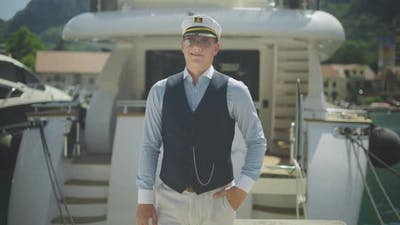 Captain standing in front of boat